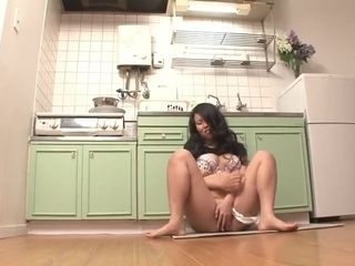Super-naughty dark haired faps in the kitchen with a fuck stick
