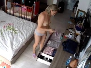 Cougar with lovely bod in her guest room unsheathed to ip camera