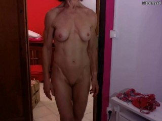 Defined GILF showcasing Her sexy Muscles