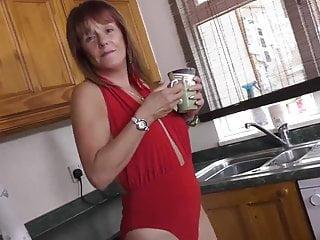 Mummy in crimson milking on her kitchen
