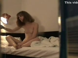 Crazy cougar gets caught frolicking with her cooch in solo